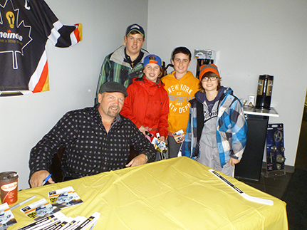 Wendel with fans Zachary, Lucas, Christopher and Myles at the grand opening of the newest Meineke in Orangeville.